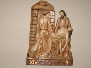 14th Station: Jesus is laid in the tomb