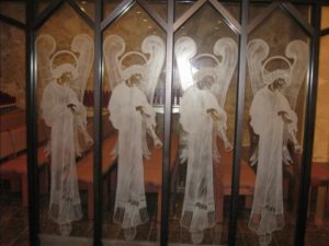 Etched glass of Angels with trumpets in committal area